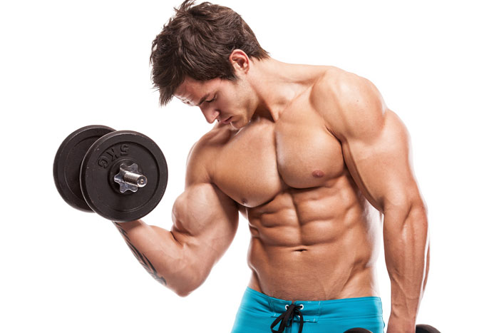 Muscle guy curling dumbells